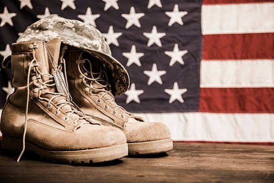 military boots in front of flag